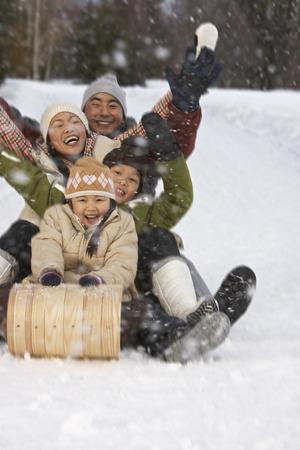 Family on Toboggan, Whistler, British Columbia, Canada LANG_EVOIMAGES
