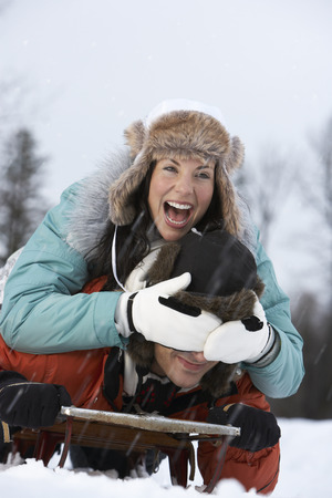 Portrait of Couple on Sled