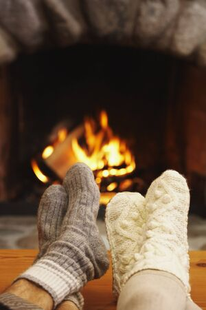 front desk: Feet in Front of Fireplace