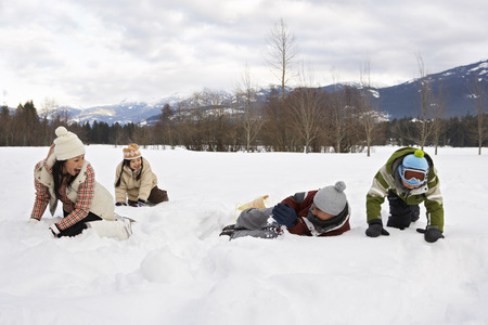 Family Playing in Snow, Whistler, British Columbia, Canada