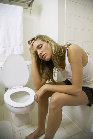 Sick Woman in Bathroom