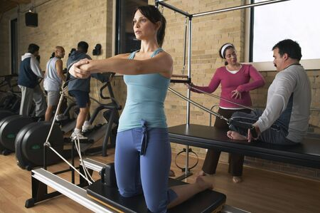 stair climber: People Exercising in Gym