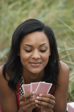 goodluck: Woman Playing Cards LANG_EVOIMAGES
