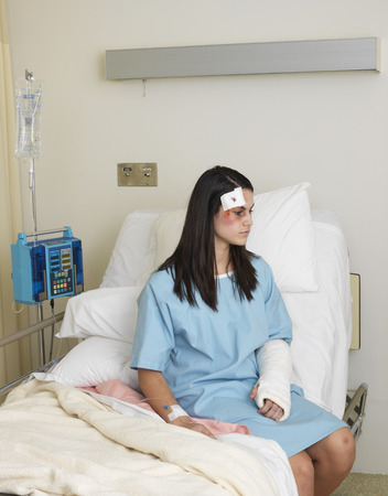 Woman in Hospital Room with Injuries LANG_EVOIMAGES