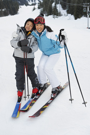 Mother and Son on Ski Hill, Whistler, British Columbia, Canada LANG_EVOIMAGES