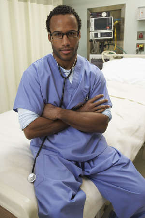 surgical department: Doctor Sitting on Empty Bed LANG_EVOIMAGES