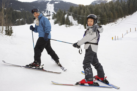 Man and Boy on Ski Hill, Whistler, British Columbia, Canada LANG_EVOIMAGES