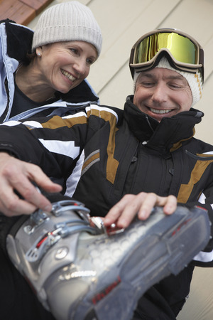 adventuresome: Couple Taking off Ski Boots, Whistler, BC, Canada