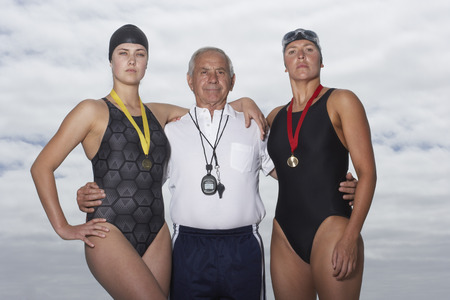 wetting: Swimmers With Coach