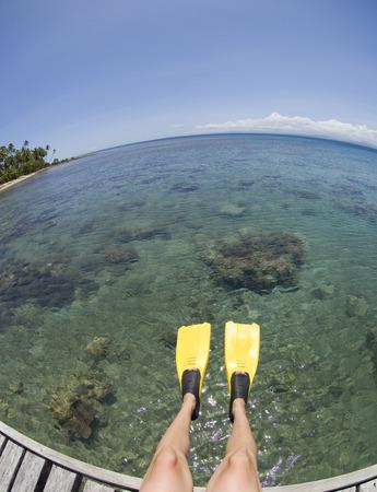 adventuresome: Snorkeller Sitting on Dock