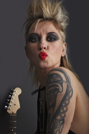 Portrait of Woman with Guitar LANG_EVOIMAGES