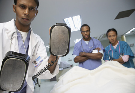 surgical department: Medical Team Treating Patient LANG_EVOIMAGES