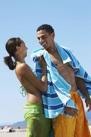 wetting: Couple at Beach