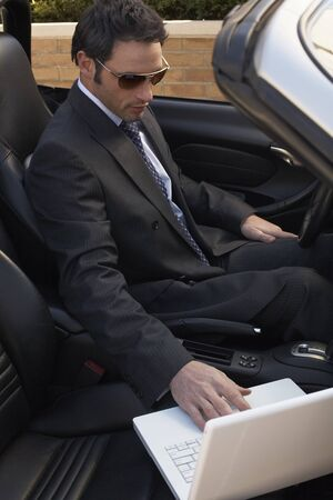 run down: Businessman in Car with Laptop Computer LANG_EVOIMAGES