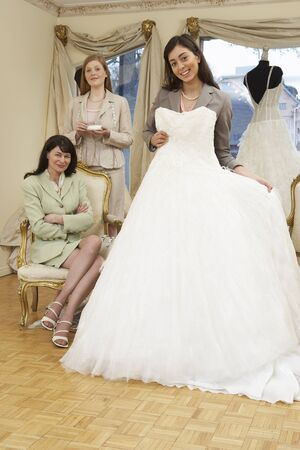 merchant: Saleswoman and Clients in Bridal Boutique