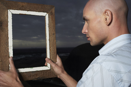 profile picture: Man Looking Through Frame