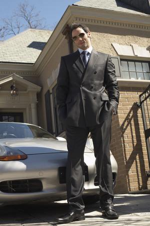 achievment: Businessman in Driveway