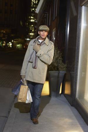 window view: Man Carrying Shopping Bags
