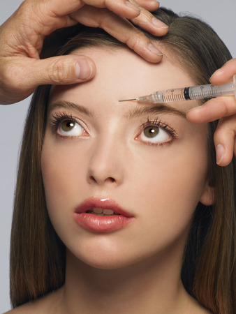 rejuvenated: Young Woman Getting Botox Injection
