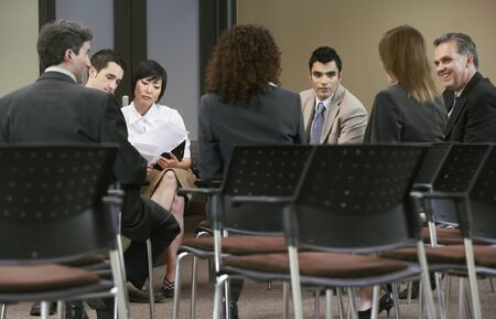 Business People at Meeting LANG_EVOIMAGES