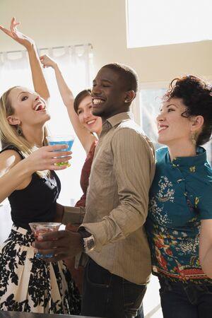 Man Dancing with Three Women