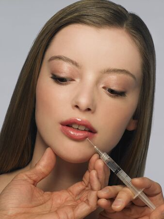 hair treatment: Young Woman Getting Botox Injection