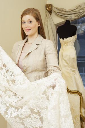merchant: Portrait of Woman in Bridal Boutique