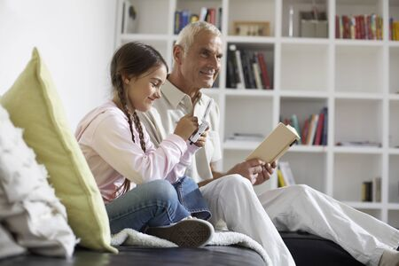 family sofa: Grandfather and Granddaughter at Home