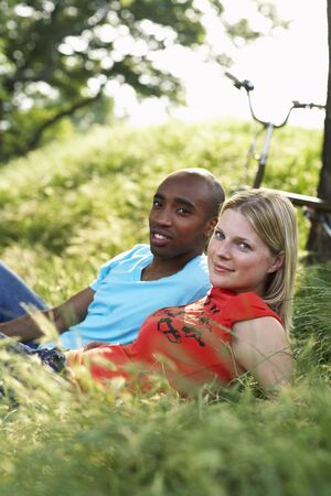Couple Lying in Grass LANG_EVOIMAGES