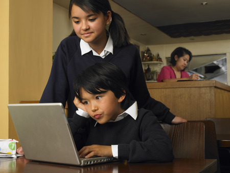 Boy and Girl with Homework in Restaurant