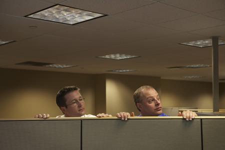 skepticism: Businessmen Peeking Over Cubicles