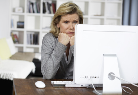 Woman Using Computer LANG_EVOIMAGES