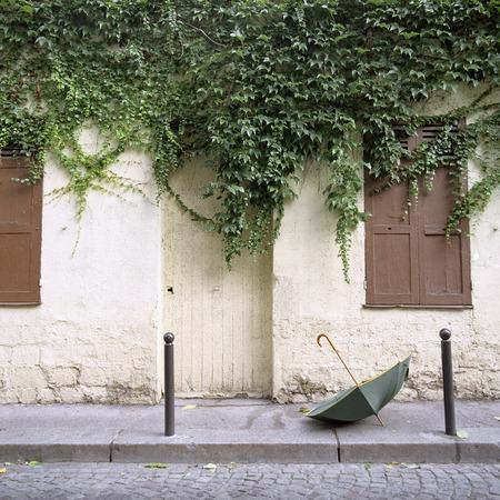 without windows: Umbrella on Sidewalk, Montmartre, Paris, France