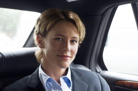 window view: Businesswoman in Car