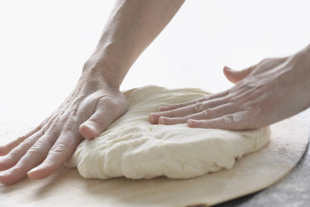 Hands Kneading Dough LANG_EVOIMAGES