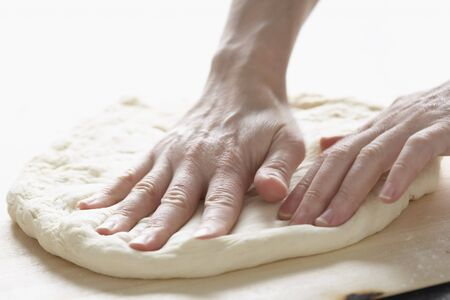counter top: Hands Kneading Dough LANG_EVOIMAGES