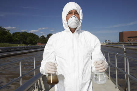 environmental issues: Man with Water Samples at Water Treatment Plant LANG_EVOIMAGES