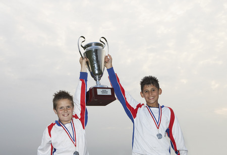 achievment: Soccer Players With Gold Medals and Trophy