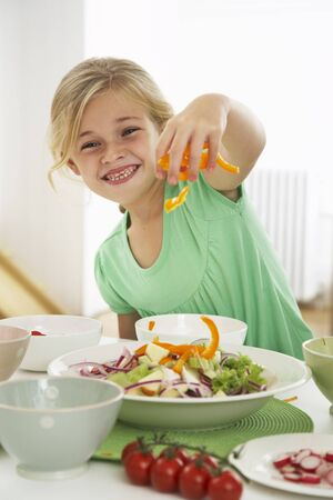 counter top: Girl Making Salad