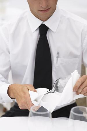 Waiter Polishing Glasses LANG_EVOIMAGES