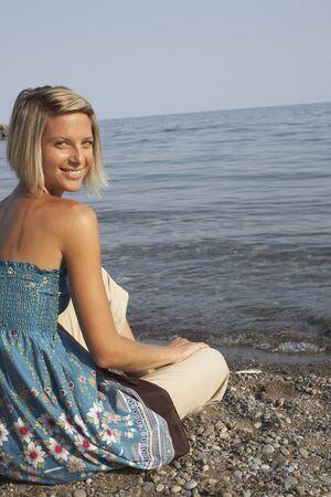 oceanic: Woman Sitting on Beach