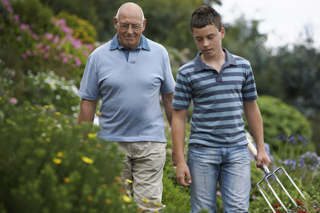 Grandfather and Grandson Gardening