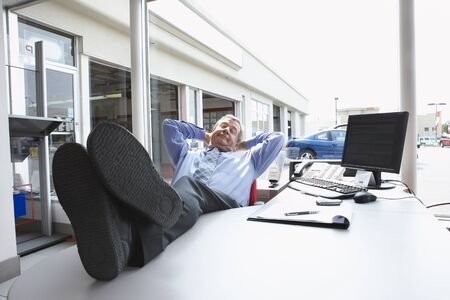 Businessman Sleeping in Office LANG_EVOIMAGES