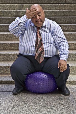 exerting: Businessman Using Exercise Ball LANG_EVOIMAGES