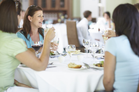 end of a long day: Women in Restaurant LANG_EVOIMAGES