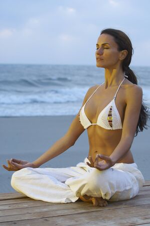 oceanic: Woman Doing Yoga at Beach