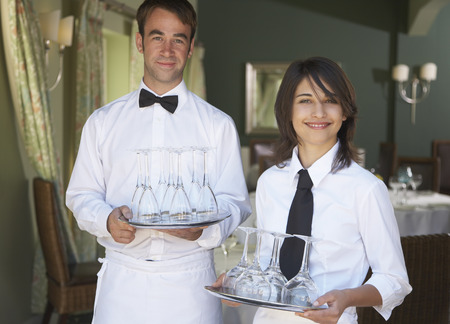 end of a long day: Waiters Carrying Trays of Wine Glasses