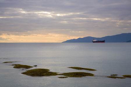 provincial tourist area: Cargo Ship at Sunset, English Bay, Vancouver, British Columbia, Canada