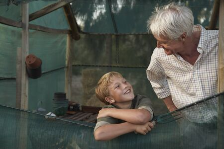 Grandfather and Grandson in Tent LANG_EVOIMAGES