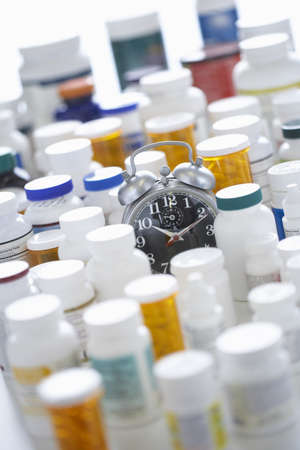 Pill Bottles and Alarm Clock LANG_EVOIMAGES